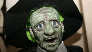 A green ghoul in a hat