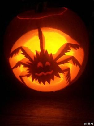 Pumpkin carved as a spider.