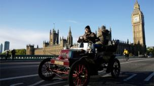 A car drives over Westminster Bridge