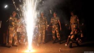 Soldiers in India light fireworks in celebration of Diwali