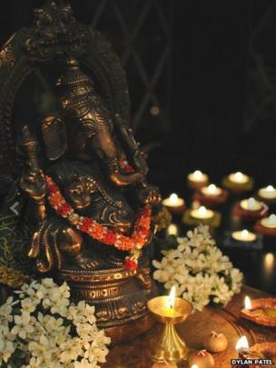 A shrine with flower garlands and candles