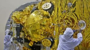 Indian engineers work on the Mars orbiter spacecraft at the satellite centre of Indian Space Research Organization (ISRO) in Bangalore, India
