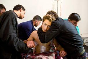 Khalid al'Bakr, a Free Syrian Army fighter receives treatment for battle injuries at a field hospital in Mah'sareen in Idlib province.