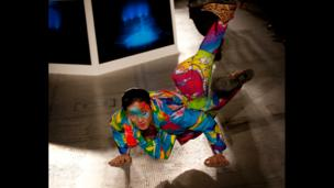A model break dances on the catwalk during Fashion in Motion: Kansai Yamamoto at the V&A, London, 1 November 2013.