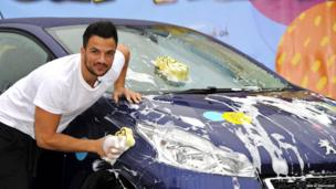 Peter Andre washes a car