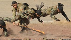 Armenian military scouts demonstrate their skill during a performance to mark the anniversary of the Armenian Armed Forces reconnaissance troops formation