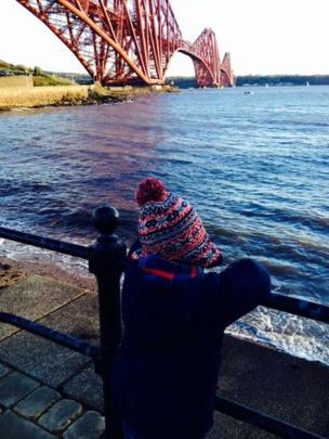 Boy looking at the Forth Bridge