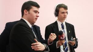 David (left) and Eoghan from St Columb's College getting the thoughts of their teacher Brendan O'Donnell (hidden) on an exhibit.