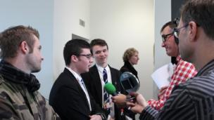 David (second left) and Eoghan from St Columb's College being interviewed by BBC Radio Ulster's Mark Patterson
