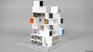 A house made up of stacked white boxes