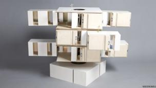 A wooden block style dolls house