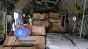 Two officials from the Indonesian air force manage relief goods inside a Hercules plane before it departs for Cebu, at the Halim military airport in Jakarta, Indonesia, 13 November 2013