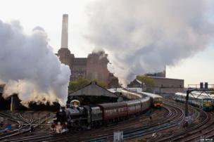 Steam engine Braunton hauls The Blue Bell Explorer train out of London Victoria