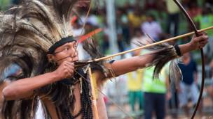 Brazilian indigenous man of the Terena tribe takes part in the bow and arrow competition