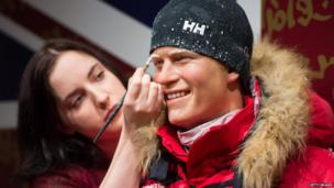 Luisa Compobassi puts finishing touches to a waxwork figure of Prince Harry in arctic clothing