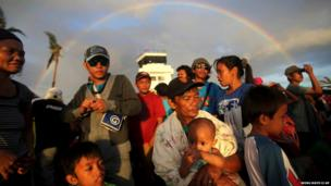 A rainbow forms over the airport in Tacloban, Leyte province, central Philippines
