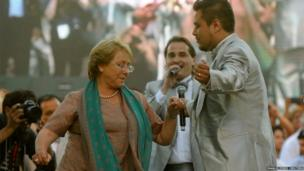 Chilean presidential candidate Michelle Bachelet of Nueva Mayoria dances during her closing campaign rally in Santiago