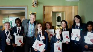 Jeremy Vine, complete with Pudsey ears, in his studio with Northwood School team
