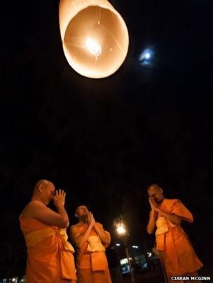 Monks launching sky lantern. Photo: Ciaran McGinn