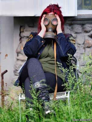 Woman in a gas mask in Toronto, Canada
