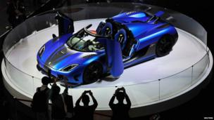 Visitors take pictures of a Koenigsegg Agera R at the Guangzhou International Automobile Exhibition