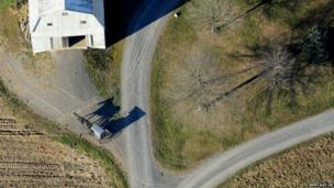 An Amish buggy heads down a driveway to a farm off of Greenleaf Road near Washingtonville, Pennsylvania