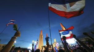 Thai national flags fly at Democracy Monument during an anti-government rally, calling for Thai Prime Minister Yingluck Shinawatra to step down, in Bangkok, Thailand, 24 November 2013