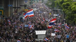 Anti-government protesters march toward Thailand's Finance Ministry in Bangkok, 25 November 2013