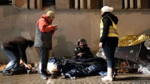 Volunteers of the French charity Les Restos du Coeur (Restaurants of the Heart) distribute hot meals to homeless people in the streets of the eastern French city of Strasbourg