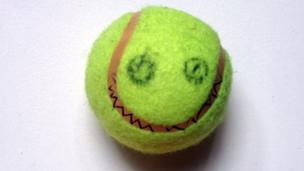 Tennis ball with face drawn on.