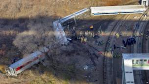 First responders gather at the derailment of a Metro North passenger train in the Bronx borough of New York