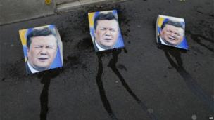 A picture in front of Ukrainian Embassy in Paris, shows pictures of Ukraine's president Viktor Yanukovych after Ukrainian feminist protest group Femen activists pretended to have urinated on them.