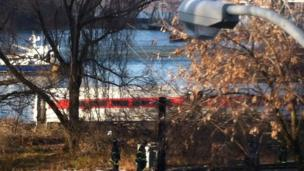 Two of train's carriages are flipped into their side
