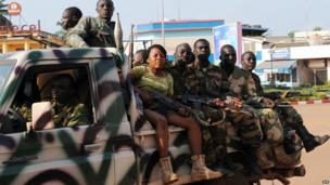Seleka soldiers - and a young woman not in uniform - on patrol on 5 December, 2013 in a street of Bangui