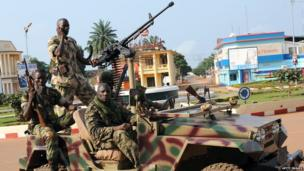 Soldiers patrol on 5 December, 2013 in a street of Bangui