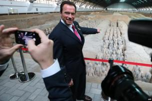 Actor and former California governor Arnold Schwarzenegger poses for a photo as he visits the Terracotta Warriors in Xian