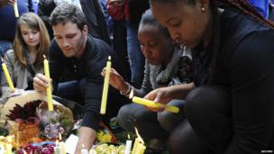 South Africans light candles for Nelson Mandela outside his Johannesburg home