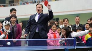 British Prime Minister David Cameron plays a game of table tennis