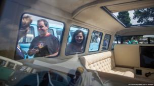 Visitors check out the interior of a custom Volkswagen Kombi minibus during an exhibition of the vehicles in Sao Bernardo do Campo, Brazil