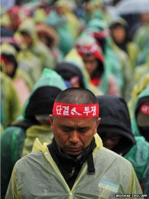 Unionised rail workers gather to strike at a Seoul railway station