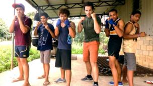 BBC Queen's Baton Relay presenter Mark Beaumont poses with Tonga's young boxing hopefuls
