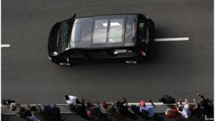 The hearse carrying the coffin of former South African President Nelson Mandela travels through a street of Pretoria December 11