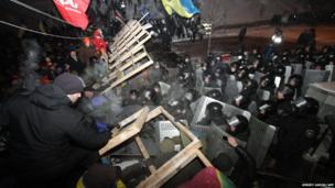 Protesters clash with riot police