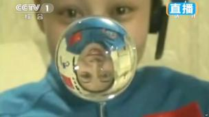 In this footage from Chinese state television, female astronaut Wang Yaping, of Shenzhou 10 spacecraft, makes a water ball in space during a lecture to students on Earth, aboard China's space module Tiangong 1, 20 June 2013