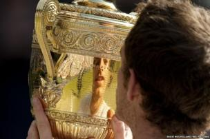 Andy Murray holds the Wimbledon Trophy