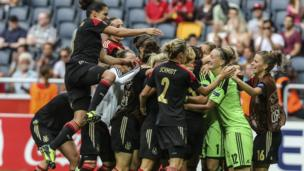 Germany women's football team celebrate on pitch