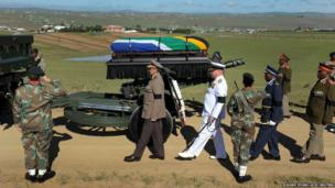 The coffin of Mandela arriving on a gun carriage for his funeral ceremony in Qunu, 15 December 2013