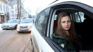Maria Alyokhina, member of Russian punk band Pussy Riot, sits in a car after her release