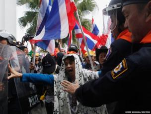 Anti-government protesters clash with riot police during a rally at the Department of Special Investigation (DSI) in Bangkok