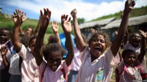Local school girls cheer excitedly as the Queen's Baton arrives in their school in Honiara, Solomon Islands.